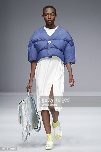 A model showcases designs on the runway at Ehoo FILYNN show during the MercedesBenz China Fashion Week Autumn/Winter 2016/2017 at 751DPARK on March...
