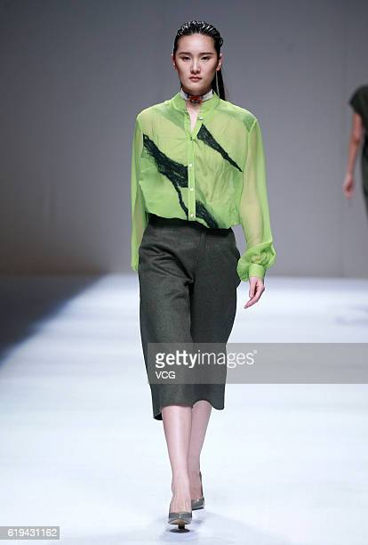 Model showcases designs on the runway at Fei Gallery & Boutique collection by Xuefei Sun during the Mercedes-Benz China Fashion Week Spring/Summer...