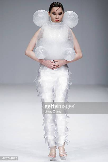 Model showcases designs on the runway at Guangdong Polytechnic Graduate Show during the day three of China Graduate Fashion Week at the 751 D.Park...