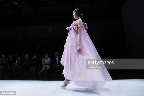 Model showcases designs on the runway at Guangzhou Nanyang Polytechnic Graduate Show during the day four of China Graduate Fashion Week at the 751...