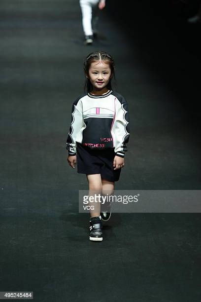 A model showcases designs on the runway at Hello Kitty My MelodyComme Tu Es Collection during the MercedesBenz China Fashion Week S/S 2016 Collection...