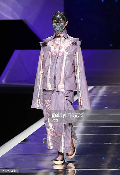 A model showcases designs on the runway at Hempel Award the 24th China International Young Fashion Designers Contest during day one of the...