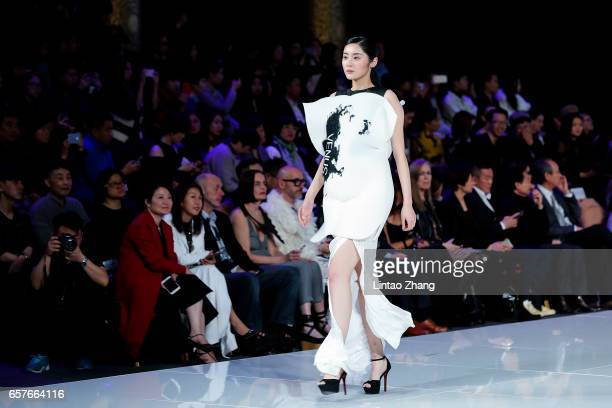 A model showcases designs on the runway at 'Hempel Award' the 25th China International Young Fashion Designers Contest during the MercedesBenz China...
