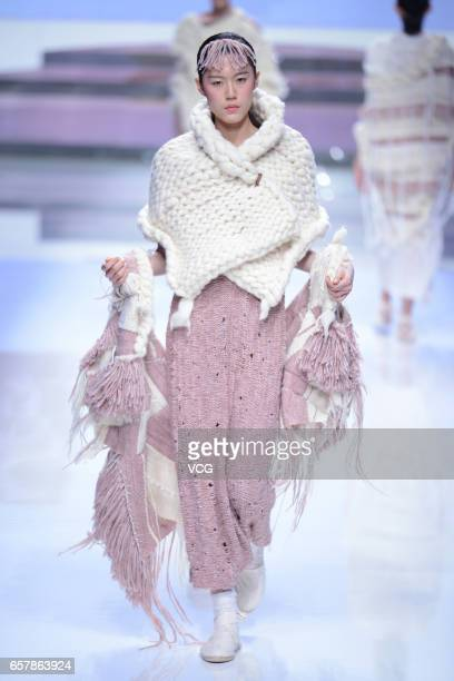 A model showcases designs on the runway at 'Hempel Award' the 25th China International Young Fashion Designers Contest during MercedesBenz China...