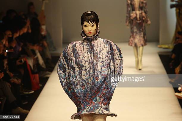 Model showcases designs on the runway at HEYUANCIYE Hu Sheguang Collection show during the seventh day of the Mercedes-Benz China Fashion Week...