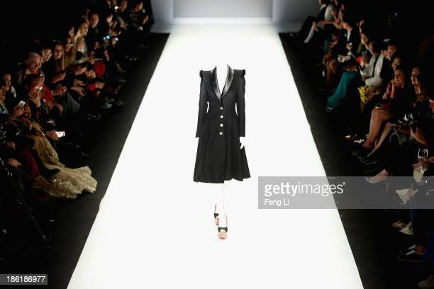 A model showcases designs on the runway at Hu Sheguang Haute Couture Collection show during MercedesBenz China Fashion Week Spring/Summer 2014 at 751...