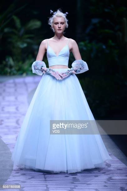 A model showcases designs on the runway at 'HUQIU Bridal City Presents JUSERE by Yu Aiping' during MercedesBenz China Fashion Week Autumn/Winter...