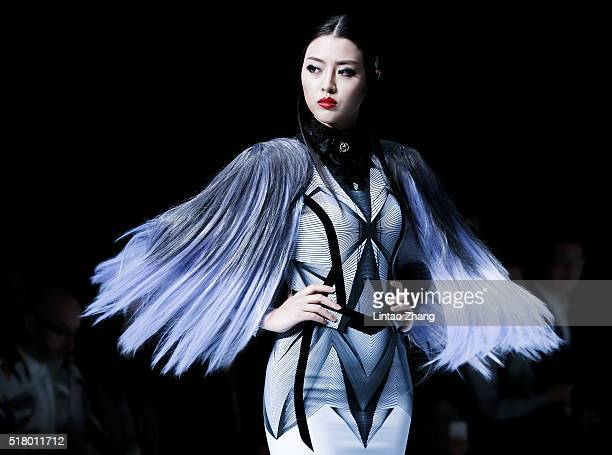 A model showcases designs on the runway at J BY HO WOWIN show during the MercedesBenz China Fashion Week Autumn/Winter 2016/2017 at 751DPARK on March...