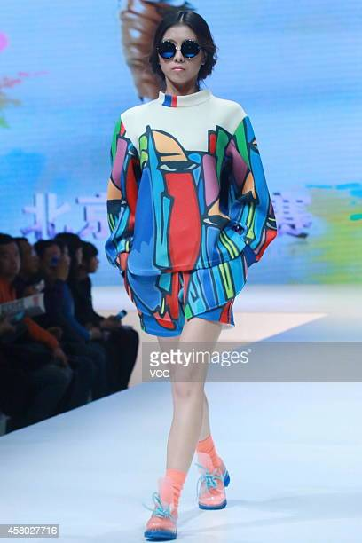 A model showcases designs on the runway at JEANSWEST Cup 23rd China Casual Wear Design Contest Final show during the fourth day of the MercedesBenz...