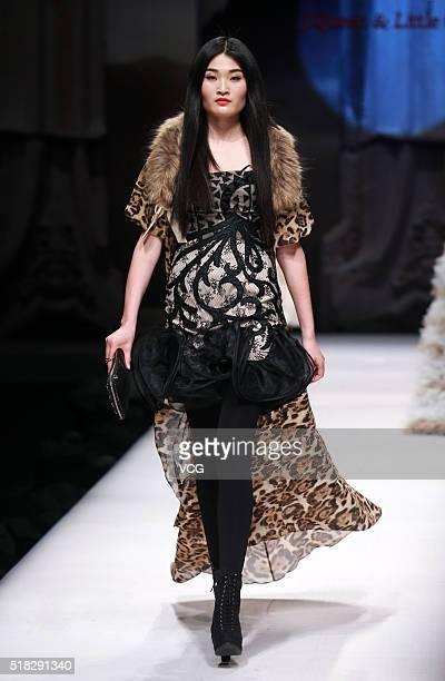 A model showcases designs on the runway at JQueen Little Collection during the MercedesBenz China Fashion Week Autumn/Winter 2016/2017 at Beijing...