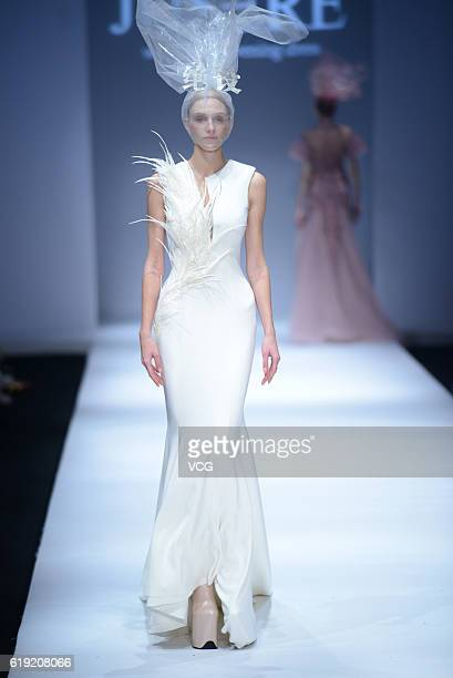 A model showcases designs on the runway at Jusere wedding and evening dress collection by Qiying Wei during the MercedesBenz China Fashion Week...