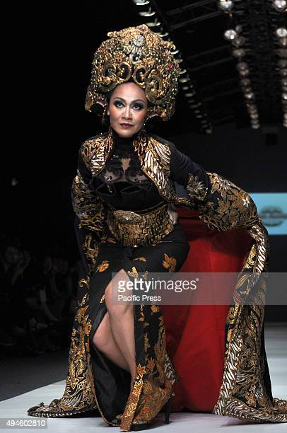 A model showcases designs on the runway at Kebaya Collection designed by Anne Avantie during the Jakarta Fashion Week 2016 at Senayan City