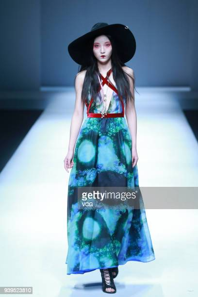 A model showcases designs on the runway at LASOMBRA show by designer DEMON DU on day four of MercedesBenz China Fashion Week Autumn/Winter 2018/2019...