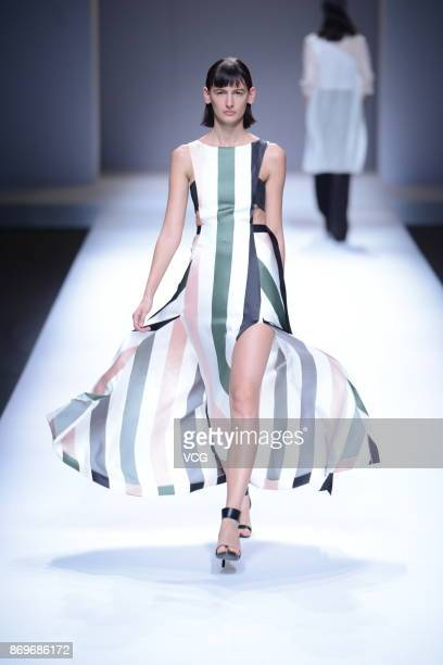 A model showcases designs on the runway at Laurel collection show during the MercedesBenz China Fashion Week Spring/Summer 2018 at Beijing Hotel on...