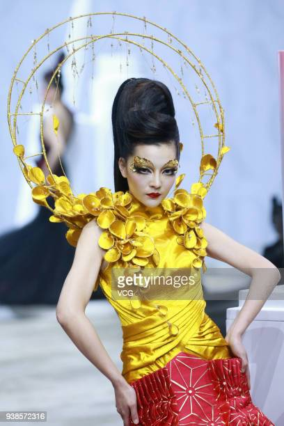 A model showcases designs on the runway at MAOGEPING show by Designer Mao Geping on day two of MercedesBenz China Fashion Week Autumn/Winter...