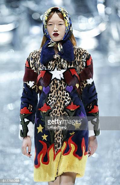 A model showcases designs on the runway at Mary Katrantzou Collection show during the MercedesBenz China Fashion Week Autumn/Winter 2016/2017 at...