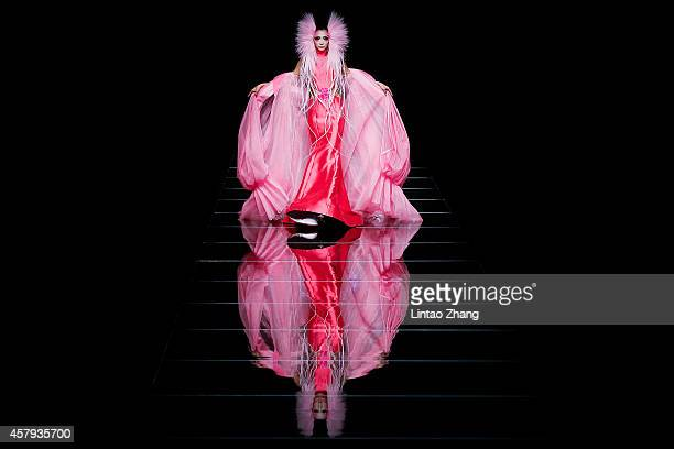 A model showcases designs on the runway at MGPIN 2015 Mao Geping Makeup Trends Launch show during day three of MercedesBenz China Fashion Week...