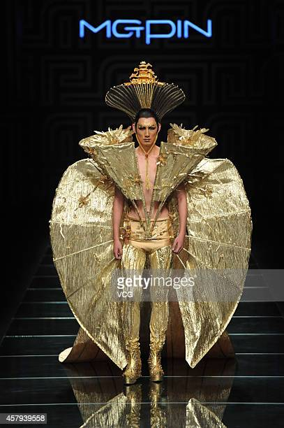 Model showcases designs on the runway at MGPIN show during the third day of the Mercedes-Benz China Fashion Week Spring/Summer 2015 at the golden...