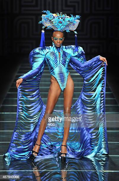 A model showcases designs on the runway at MGPIN show during the third day of the MercedesBenz China Fashion Week Spring/Summer 2015 at the golden...