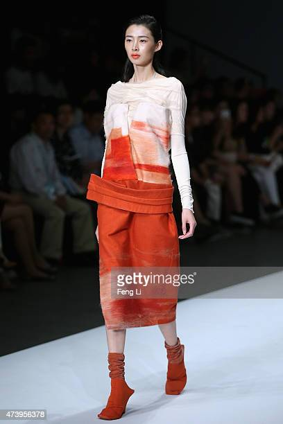 Model showcases designs on the runway at Minzu University of China Academy of Fine Arts Graduates Show during the day five of China Graduate Fashion...