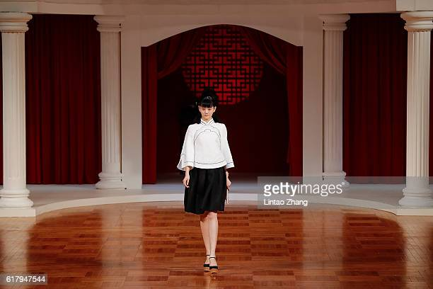 A model showcases designs on the runway at NE TIGER show during MercedesBenz China Fashion Week Spring/Summer 2017 at Beijing Hotel on October 25...
