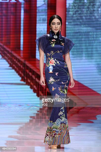 A model showcases designs on the runway at NETIGER Haute Couture Collection during the MercedesBenz China Fashion Week S/S 2016 at Beijing Hotel on...