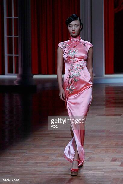A model showcases designs on the runway at NETIGER Haute Couture Collection during the MercedesBenz China Fashion Week Spring/Summer 2017 at Beijing...