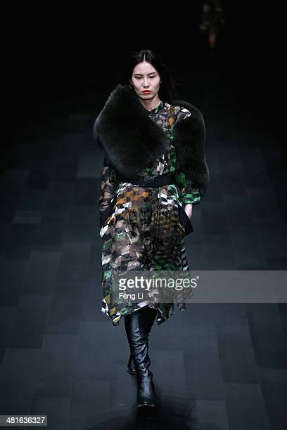 A model showcases designs on the runway at PREEN Collection Autumn/Winter 2014 Show during MercedesBenz China Fashion Week Autumn/Winter 2014/2015 at...