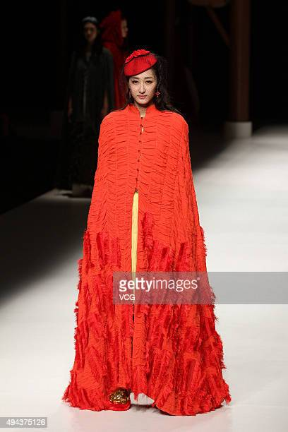 A model showcases designs on the runway at Qing's Zheng Qinger Collection during the MercedesBenz China Fashion Week Spring/Summer 2016 at Beijing...