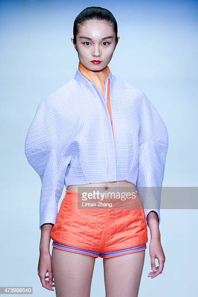Model showcases designs on the runway at School of Art Design, China Women's University Graduates Show during the day five of China Graduate Fashion...