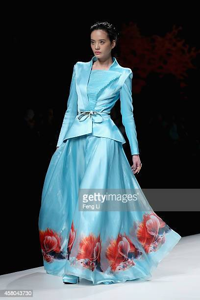 Model showcases designs on the runway at SEC Qi Gang Collection show during Mercedes-Benz China Fashion Week Spring/Summer 2015 at Beijing Hotel on...