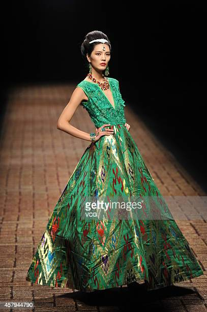 A model showcases designs on the runway at Silk Road Star Cheng Yingfen Collection show during the third day of the MercedesBenz China Fashion Week...