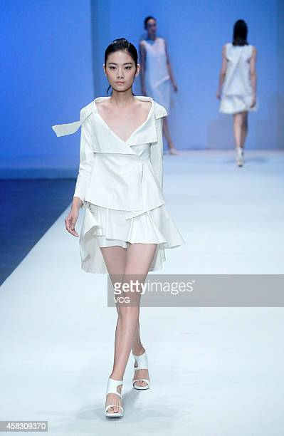 Model showcases designs on the runway at SON JUNG WAN Collection show during the Mercedes-Benz China Fashion Week Spring/Summer 2015 at Central Hall,...
