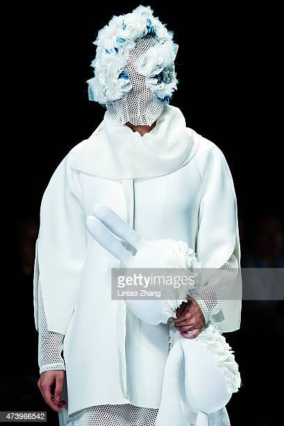 Model showcases designs on the runway at Southwest University Graduates Show during the day five of China Graduate Fashion Week at the 751 D.Park...