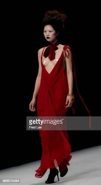 A model showcases designs on the runway at the Ae'lkemi Collection show during the MercedesBenz China Fashion Week Spring/Summer 2018 Collection at...