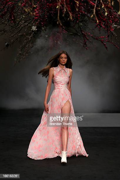 A model showcases designs on the runway at the Aje show during MercedesBenz Fashion Week Australia Spring/Summer 2013/14 at Carriageworks on April 9...