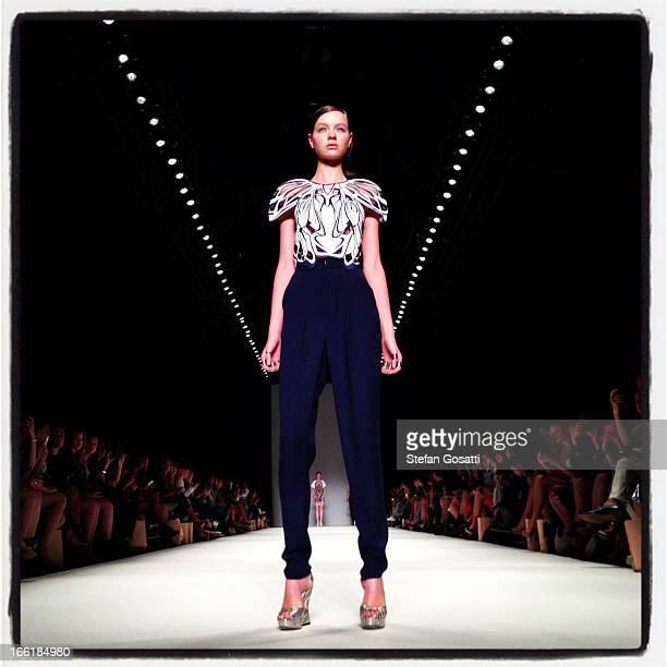 A model showcases designs on the runway at the Alice McCall show during MercedesBenz Fashion Week Australia Spring/Summer 2013/14 at Carriageworksat...