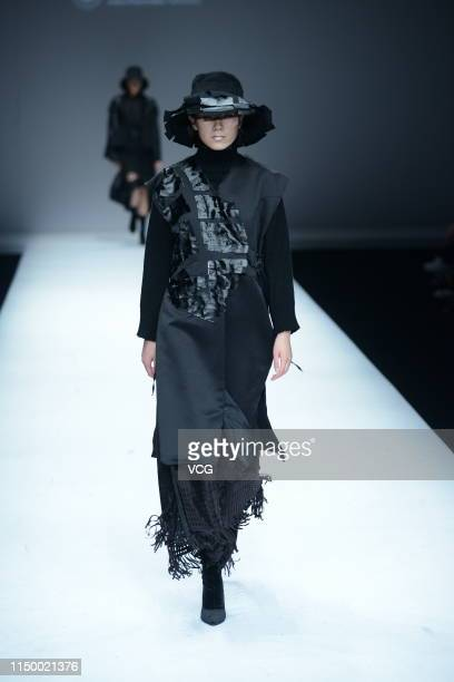 Model showcases designs on the runway at the 'Anhui Polytechnic University Textile and Garment College' show on day four of China International...