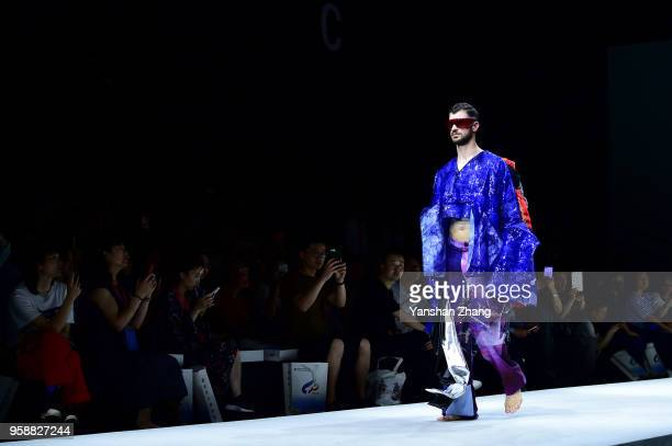 Model showcases designs on the runway at the Changzhou Vocational Institute Of Textile And Garment Show during the day 3 of China Graduate Fashion...