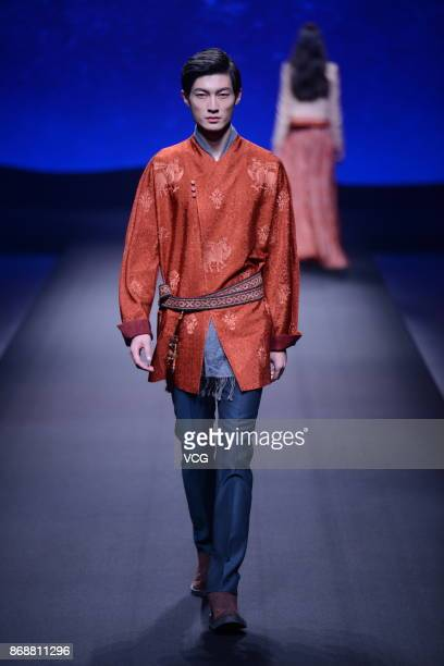 A model showcases designs on the runway at the Chuhetingxiang collection by designer Chu Yan during the MercedesBenz China Fashion Week Spring/Summer...