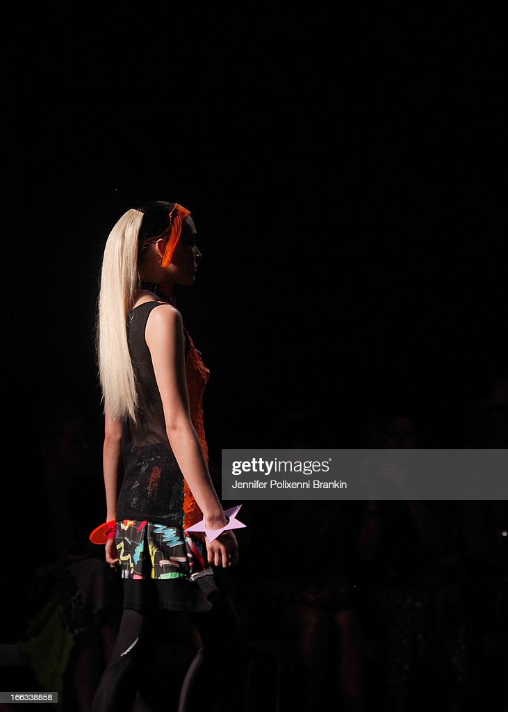 A model showcases designs on the runway at the Emma Mulholland show during Mercedes-Benz Fashion Week Australia Spring/Summer 2013/14 at Carriageworks on April 11, 2013 in Sydney, Australia.