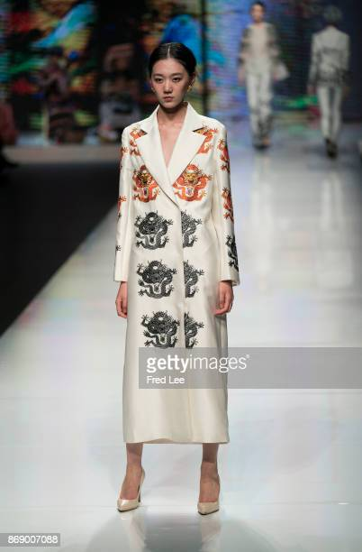 A model showcases designs on the runway at the EVE CINA Collection show during the MercedesBenz China Fashion Week Spring/Summer 2018 Collection at...