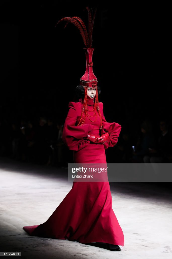 A model showcases designs on the runway at the Haute Couture Collection show by designer Hu Sheguang during the Mercedes-Benz China Fashion Week Spring/Summer 2018 Collection at the 798 Art Park on November 7, 20172017 in Beijing, China.