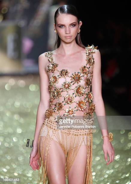 Model showcases designs on the runway at the Hello Elle Australia show during Mercedes-Benz Fashion Week Australia Spring/Summer 2013/14 at...