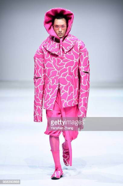 Model showcases designs on the runway at the Hubei Institute of Fine Arts Show during the day 1 of 2018 China Graduate Fashion Week at the 751 D.Park...