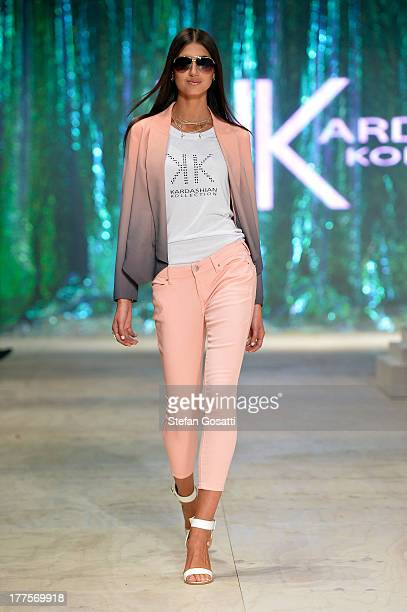 A model showcases designs on the runway at the Kardashian Kollection show during MercedesBenz Fashion Festival Sydney 2013 at Sydney Town Hall on...