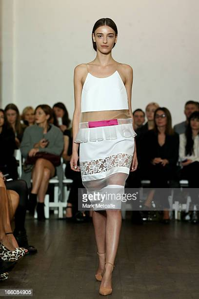 A model showcases designs on the runway at the Karla Spetic show during MercedesBenz Fashion Week Australia Spring/Summer 2013/14 at Carriageworks on...