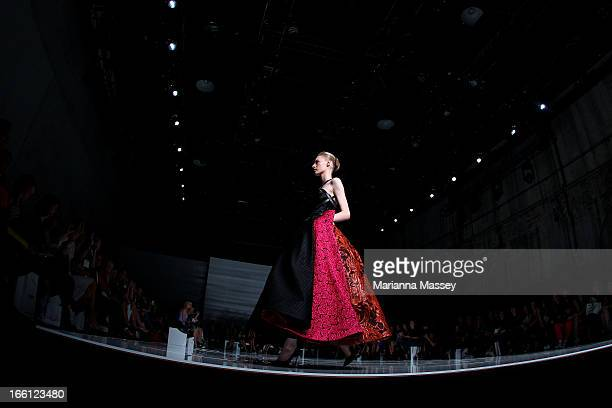 A model showcases designs on the runway at the Maticevski show during MercedesBenz Fashion Week Australia Spring/Summer 2013/14 at Carriageworks on...