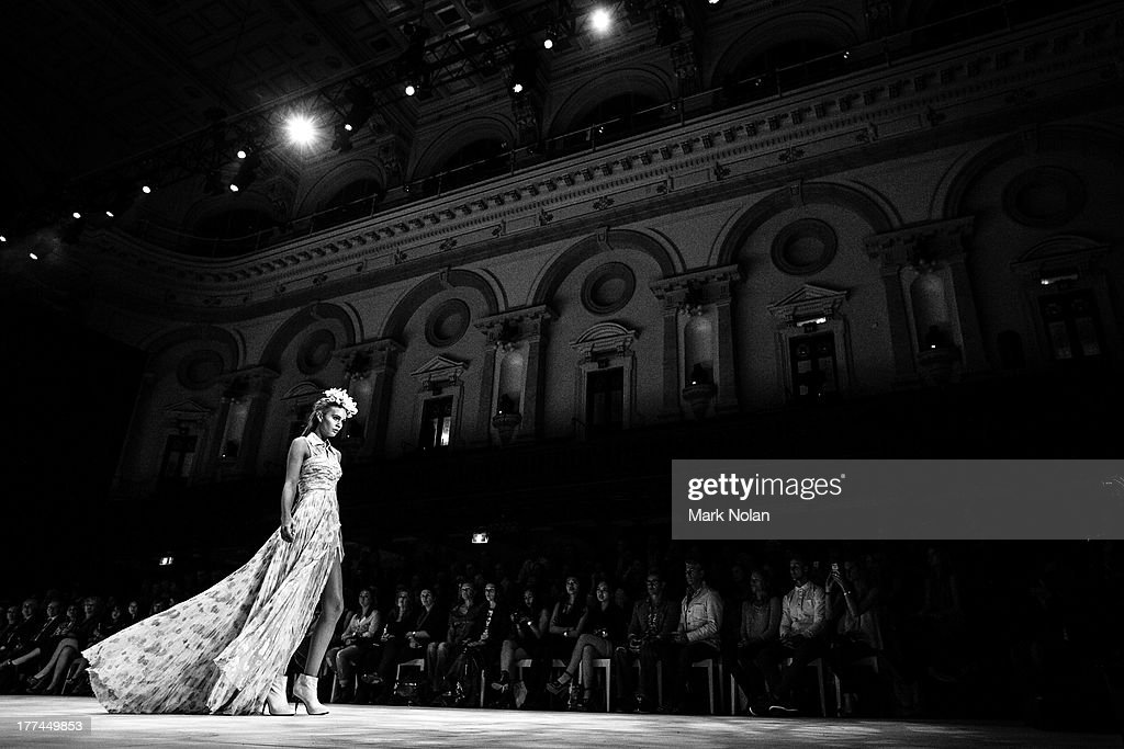 A model showcases designs on the runway at the MBFWA Trends show during Mercedes-Benz Fashion Festival Sydney 2013 at Sydney Town Hall on August 23, 2013 in Sydney, Australia.