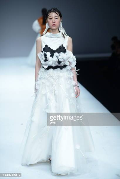 A model showcases designs on the runway at the 'Northeast Electric Power University' show on day one of China International College Student Fashion...